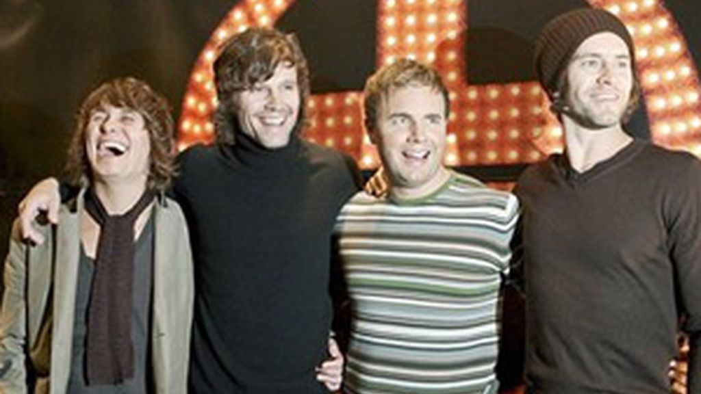 Mark Owen, Jason Orange, Gary Barlow y Howard Donald.