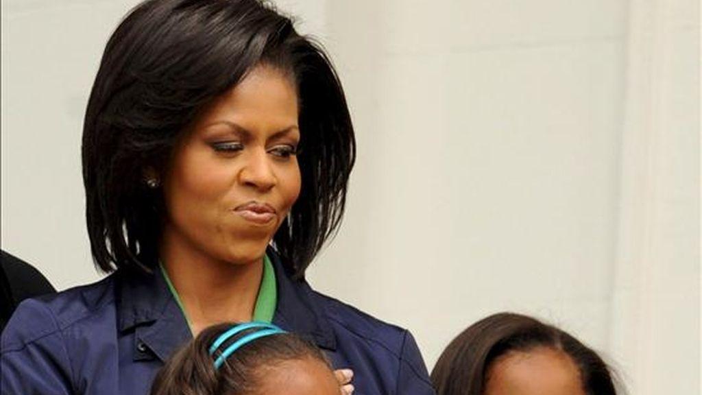 Las pequeñas Obama acabaron ayer las clases y lo celebrarán con una reunión familiar en la capital francesa, a la que hoy también llega el presidente de EE.UU., Barack Obama, tras su paso por Egipto y Alemania. EFE/Archivo