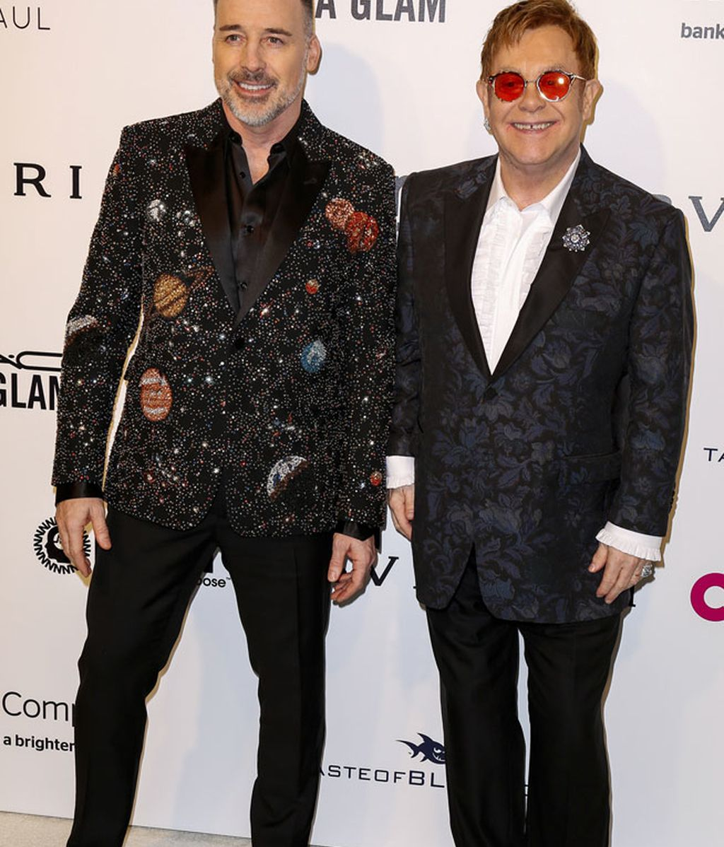 Elton John junto a su marido David Furnish, anfitriones de la fiesta