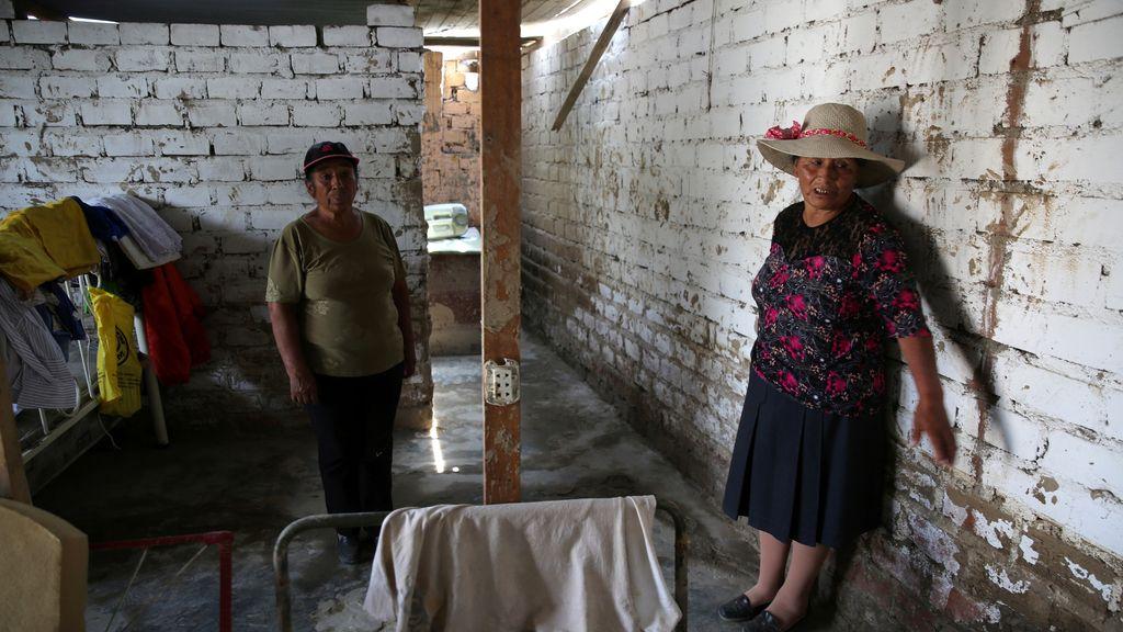 Los habitantes de Carapongo en Perú vuelven a sus casas destruidas por una ríada