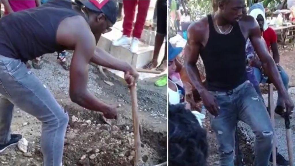 Usain Bolt cava la tumba de un amigo muerto en un accidente de moto