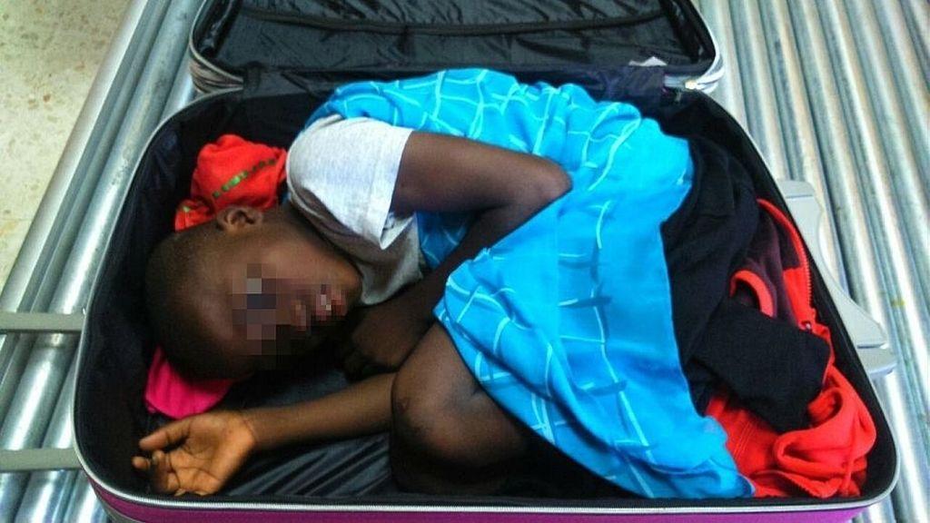 Abou-niño de la maleta
