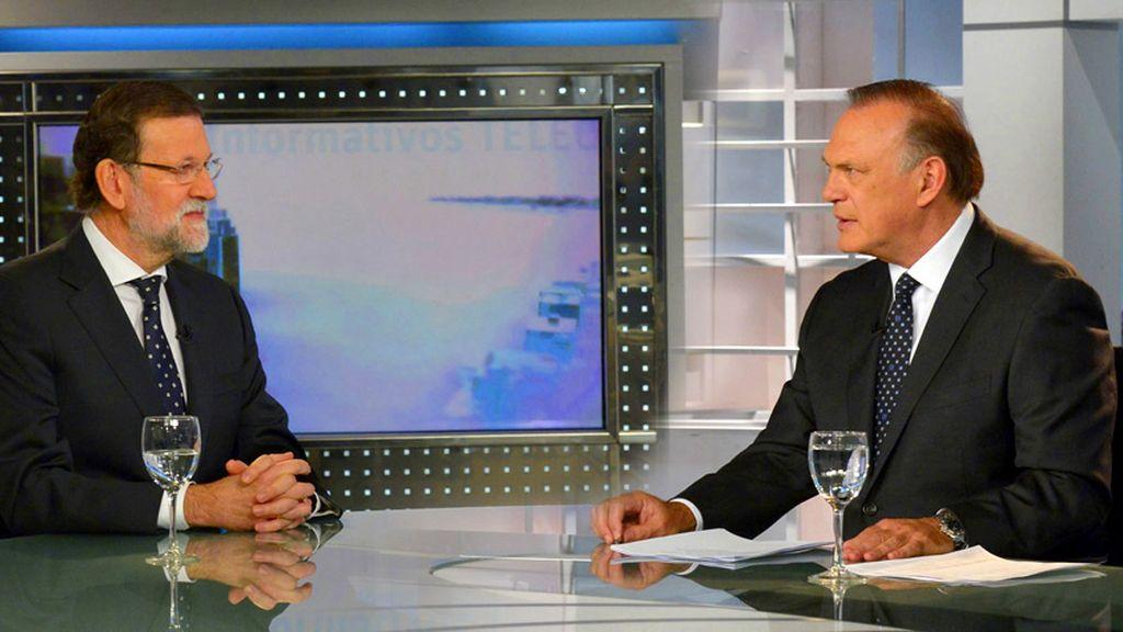 Pedro Piqueras y Mariano Rajoy