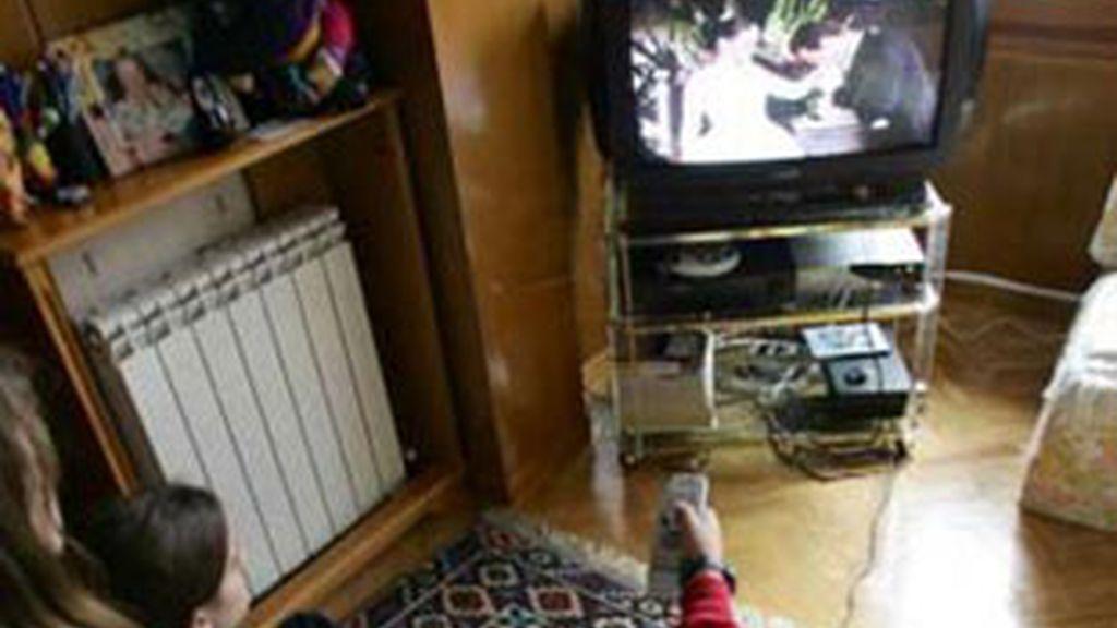 Espectadores de televisión.
