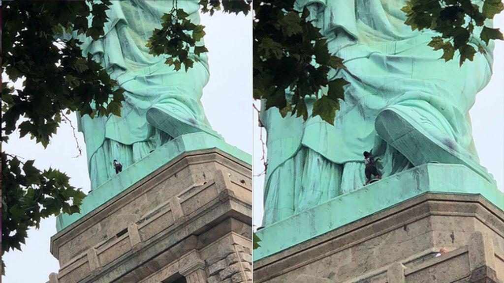 Una mujer escala la Estatua de la Libertad en protesta por la política migratoria de Trump