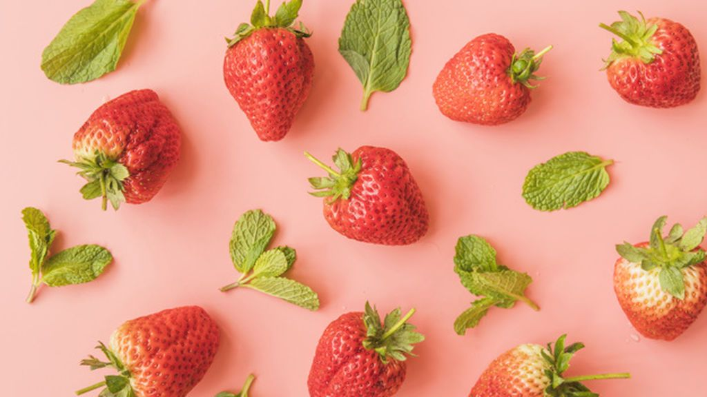 ripe-strawberries-mint-leaves-background_23-2148102479