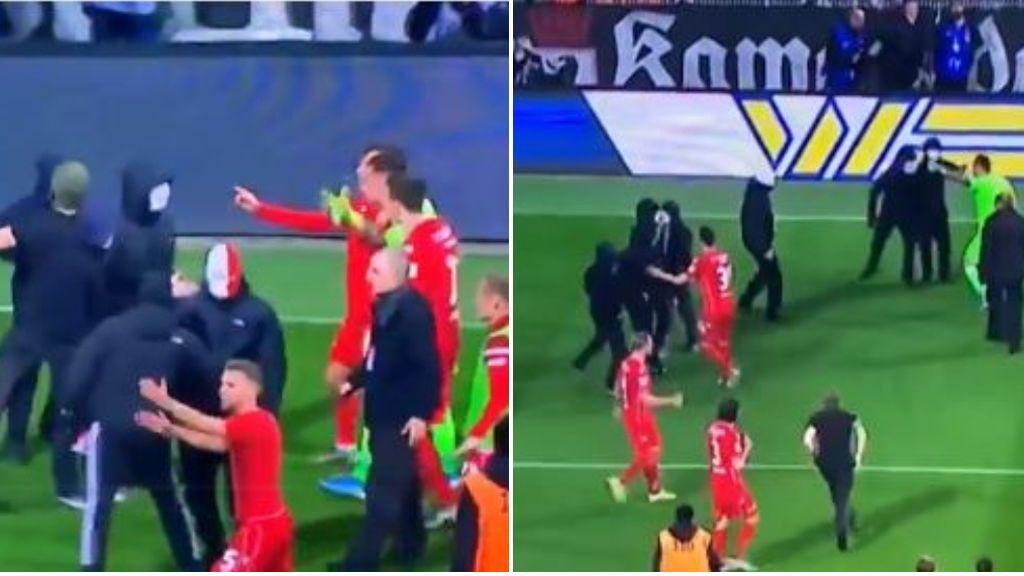 Los jugadores del Union Berlín hacen frente a los ultras para evitar la suspensión del partido