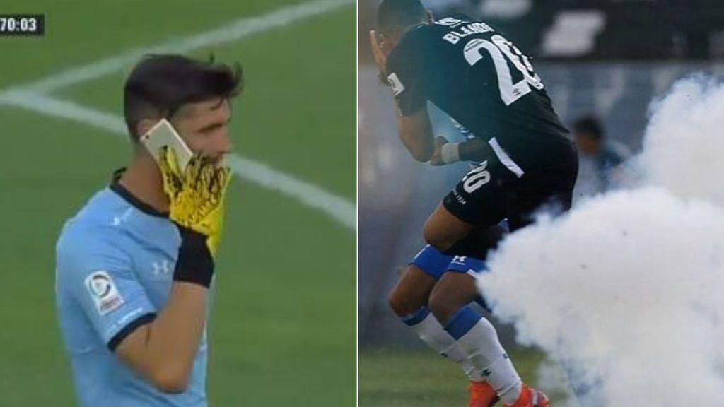 Lanzan un teléfono móvil para agredir a un portero, se pone a hablar con él y suspenden el partido por herir con petardos a un jugador