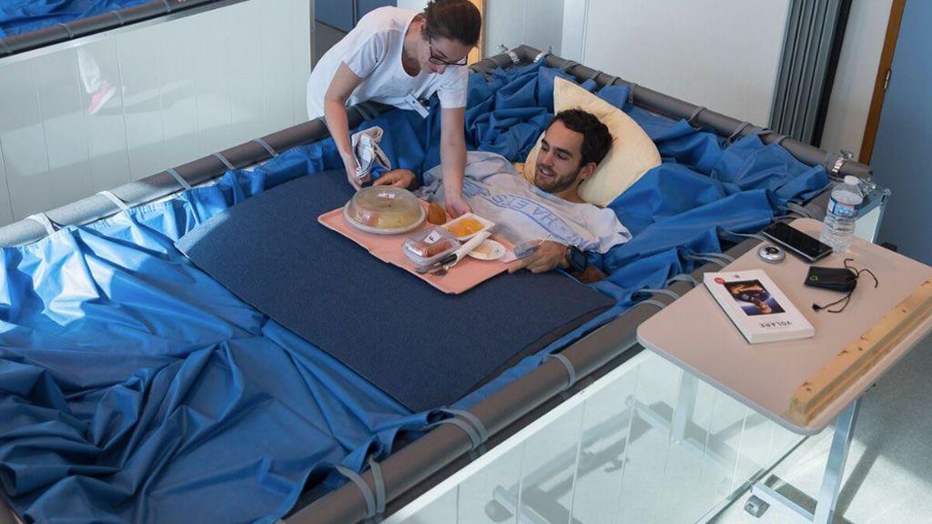 Antiguo experimento con hombres de camas de agua