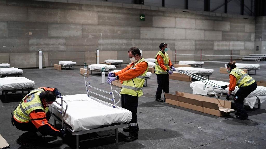 Madrid prepara un hospital de campaña en el Ifema para atender a los enfermos por coronavirus, en imágenes