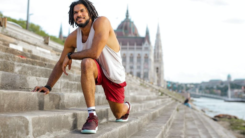 man-stretching-on-concrete-stairs-3766202