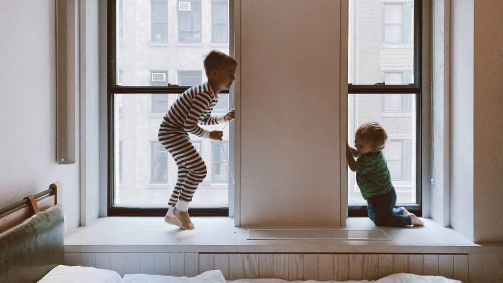 two-kids-playing-beside-glass-windows-3273851